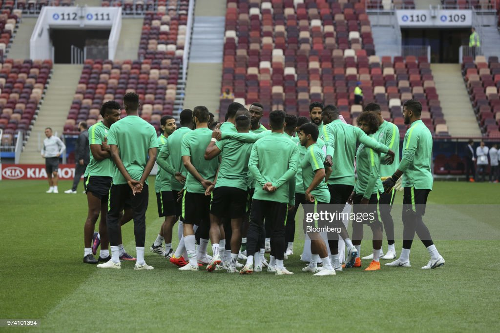 The Saudi Arabia football team converse during a practice session ahead of the FIFA World Cup opening match at the Luzhniki stadium in Moscow, Russia, on Wednesday, June 13, 2018. According to an April report from the organizing committee, the total amount spent on preparations is 683 billion rubles, or about $11 billion at the current exchange rate. Photographer: Andrey Rudakov/Bloomberg via Getty Images