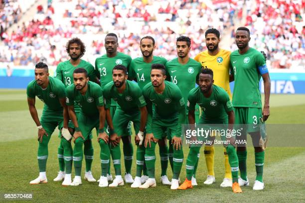 The Saudi Arabia players line up for a team photo prior to the 2018 FIFA World Cup Russia group A match between Saudi Arabia and Egypt at Volgograd...