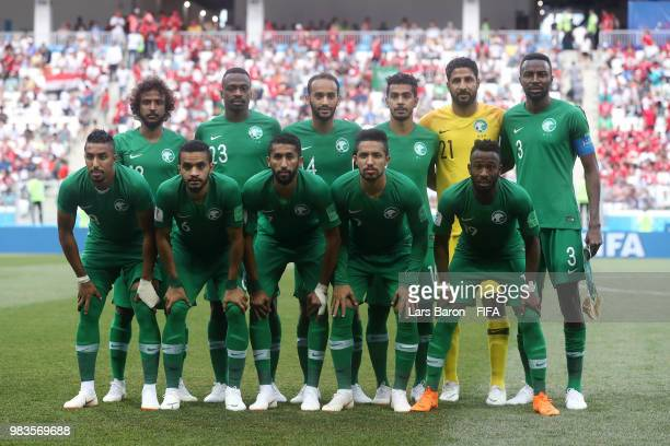 The Saudi Arabia players pose for a team photo prior to the 2018 FIFA World Cup Russia group A match between Saudia Arabia and Egypt at Volgograd...