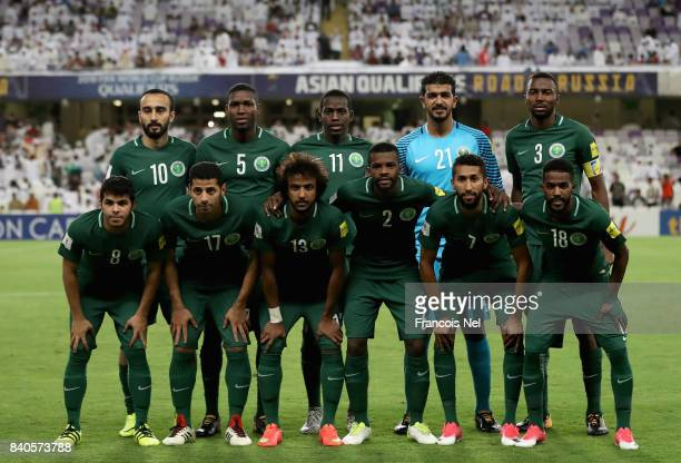 The Saudi Arabia team pose for a team photo prior to the FIFA 2018 World Cup qualifying match between United Arab Emirates and Saudi Arabia at Hazza...