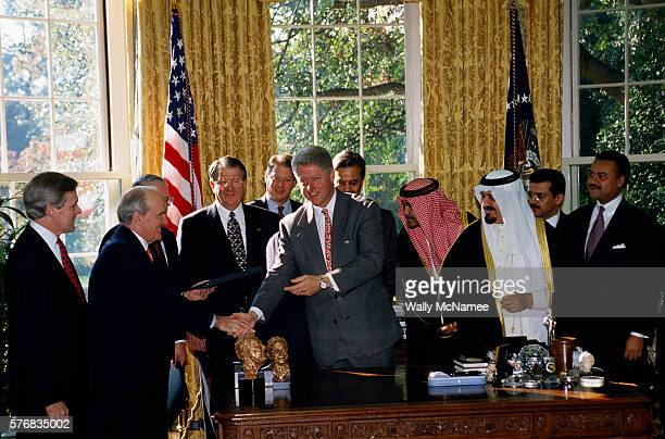 The Saudi government presents contracts to American airplane in the Oval Office President Clinton shakes hand with GE CEO Jack Welch while Frank...