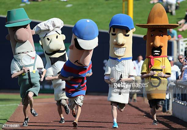 The Sausage Race mascots compete during the spring training game between the San Diego Padres and Milwaukee Brewers at Maryvale Baseball Park on...