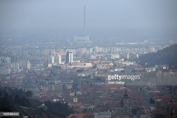 The Saxonbuilt historic district stands next to Stalinera industry and apartments blocks on March 9 2013 in Brasov Romania Historic Brasov in German...