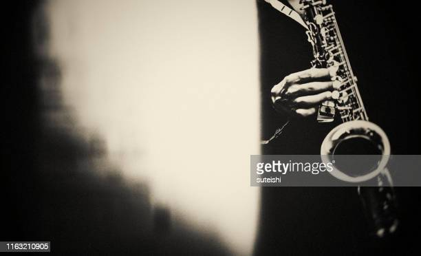 the saxophone player at the jazzclub - jazz stock pictures, royalty-free photos & images