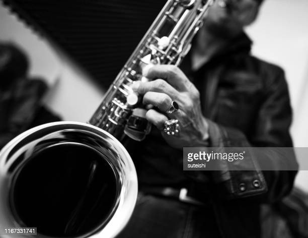the saxophone player - soul music stock pictures, royalty-free photos & images