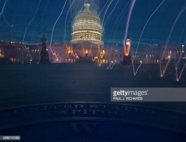 The scaffolded US Capitol is seen overlooking an official marker looking West the camera moved to create highlight streaks October 28 2014 in...