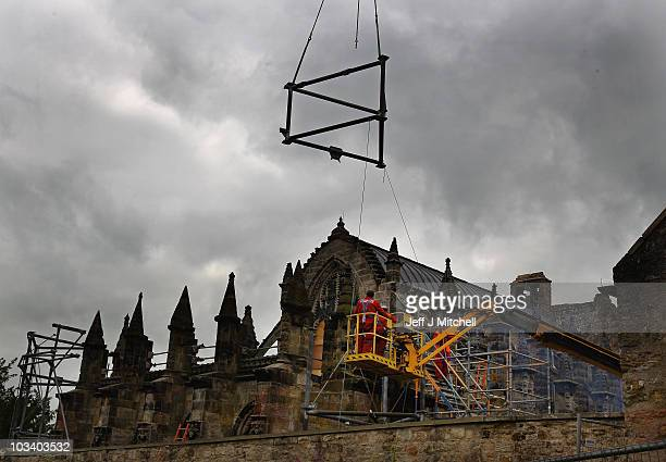 The scaffolding is removed by workers at the 550 year old Rosslyn Chapel on August 16 2010 in Rosslyn Scotland The chapel made famous by the Da Vinci...