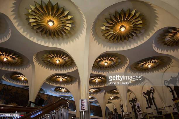 The Scala Cinema foyer is made up of a huge domed ceiling, ornately decorated with art deco bronzed flowers. The double circular staircases wind up...
