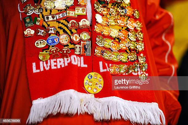 The scarf and pin badges belonging to a Liverpool fan are seen prior to kickoff during the Barclays Premier League match between Liverpool and...