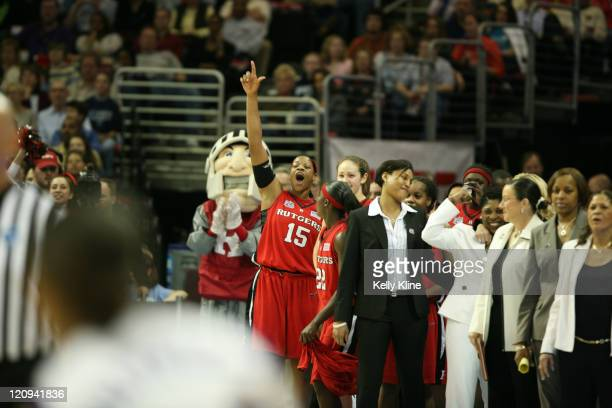 The Scarlet Knights celebrate their win during the semifinal of the NCAA Women's basketball tournament at Quicken Loans Arena in Cleveland Ohio on...