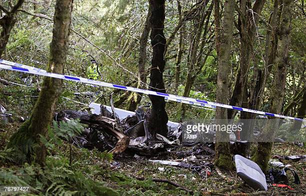 The scene after the helicopter in which former rally world champion Colin McRae was flying crashed near his home in Lanark in Scotland 17 September...