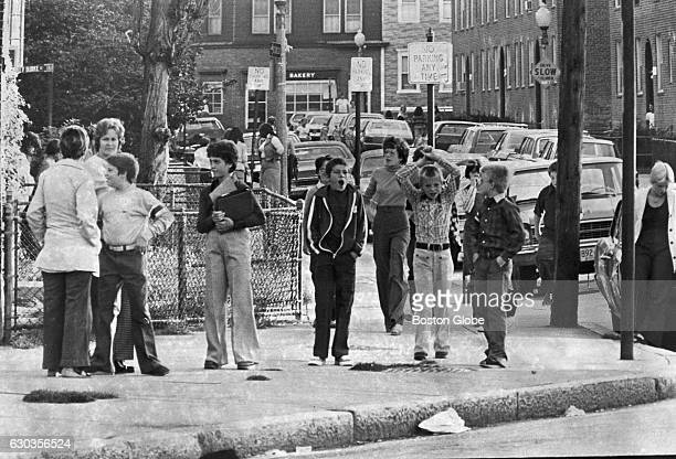 The scene as children walk near Mercer Street and Columbia Road near the South Boston housing project on Sept 8 1977 An initiative to desegregate...