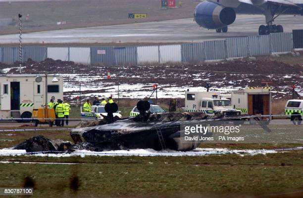 The scene at Birmingham International Airport where five people were feared dead after a private executive jet crashed in a fireball during takeoff...