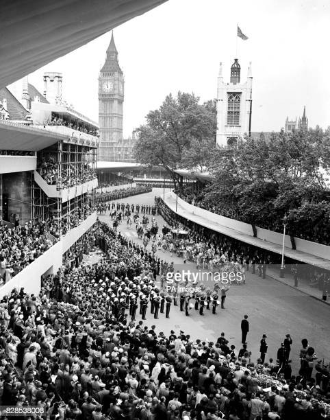 The scene at Westminster as Queen Elizabeth II riding with the Duke of Edinburgh in a golden State Coach drawn by eight grey horses arrives at the...