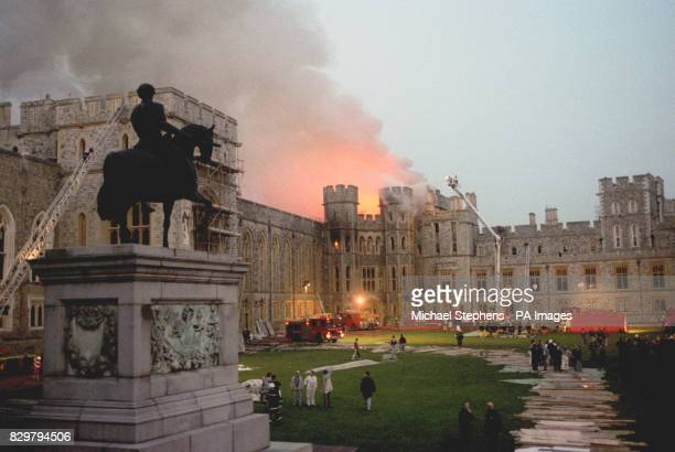 The scene at Windsor Castle as dusk falls after the fire swept through the royal home