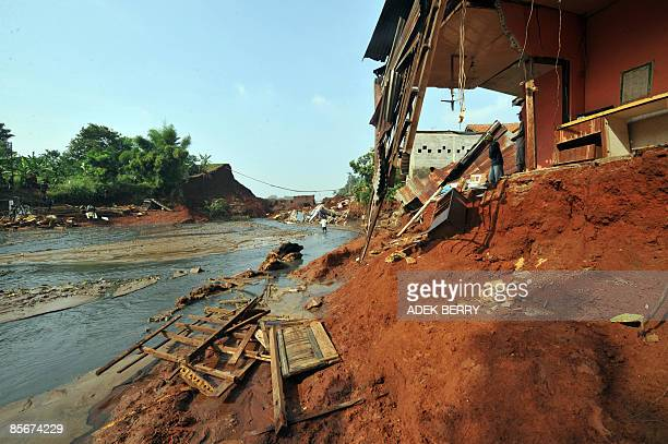 The scene close to Situgintung dam after it bursted its wall early on March 27, in Tangerang on March 28, 2009. Rescue workers in Indonesia searched...