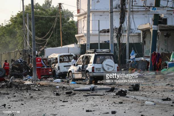 The scene following twin car bombs that exploded within moments of each other in the Somali capital Mogadishu on November 9 2018 At least 10 people...