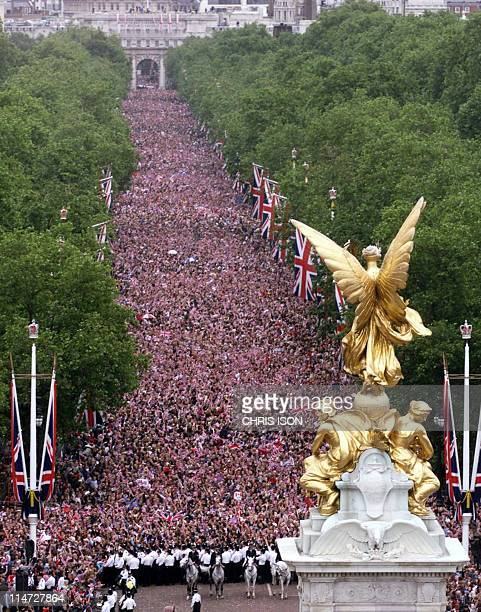 The scene from the roof of Buckingham Palace as crowds gather to watch the Jubilee Flypast of 27 aircraft including the Red Arrows and Concorde fly...