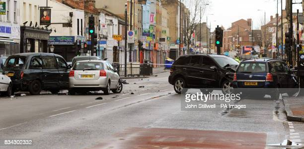 The scene in Bethnal Green Road east London after a black Mercedes fourwheel drive jeep being pursued by a police car crashed into several cars...
