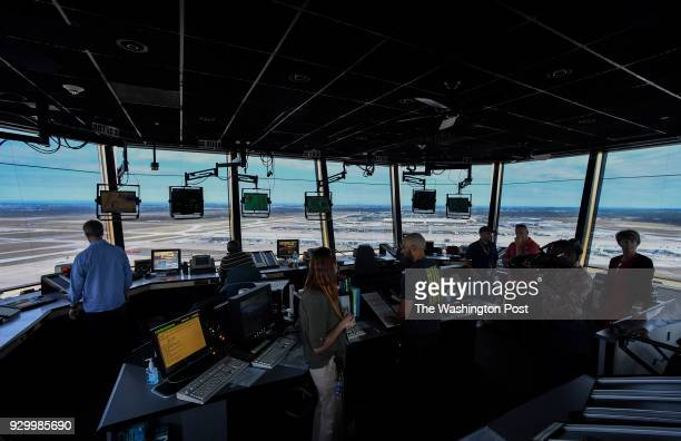 The scene in the air traffic control tower at Dulles International Airport during a tour by The Federal Aviation Administration along with UPS and...