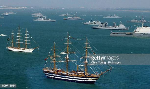 The scene in the Solent with Italian three mast full rigged sailing ship Amerigo Vespucci in foreground where ships have anchored at Spithead off...