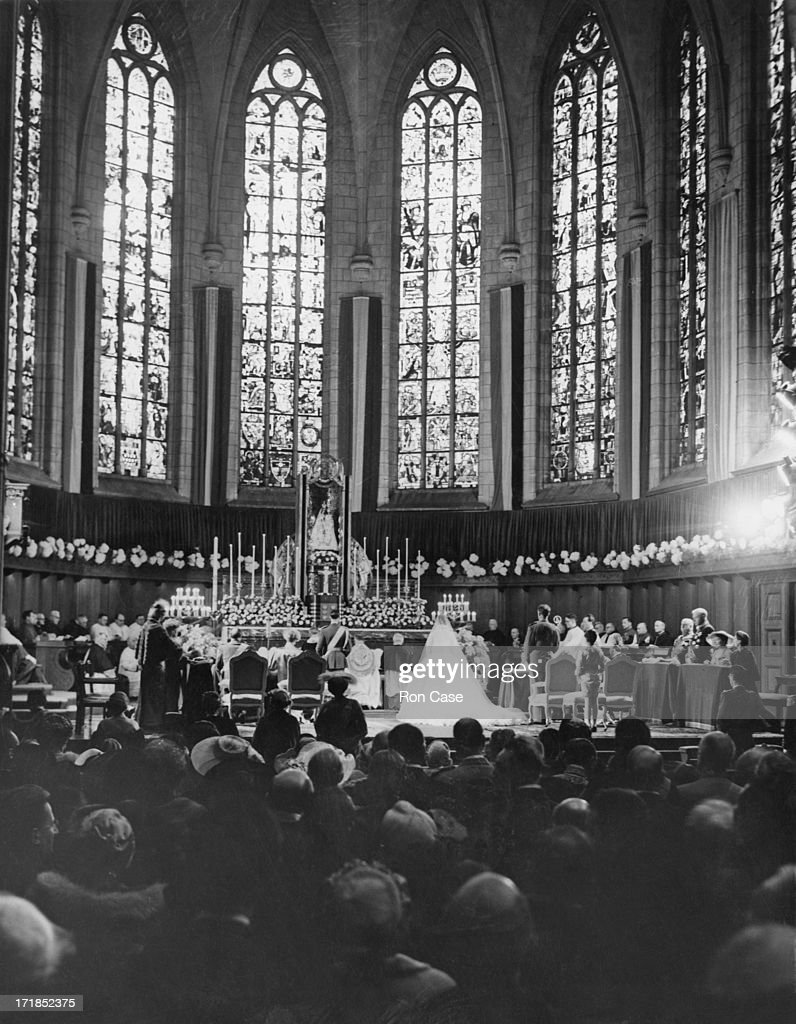 The scene inside Luxembourg Cathedral during the wedding ceremony of Princess Josephine-Charlotte of Belgium (1927 - 2005) and Grand Duke Jean of Luxembourg, Luxembourg, 9th April 1953.