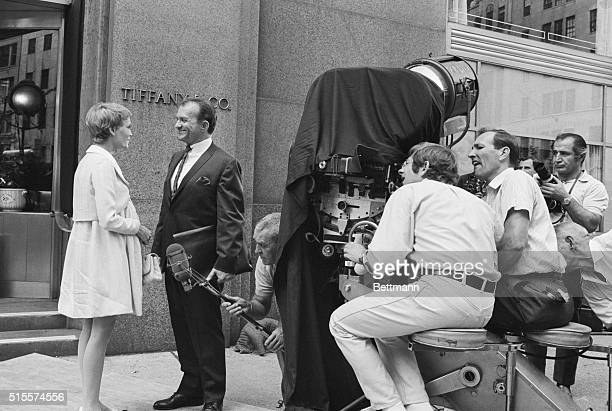 The scene is New York's Fifth Avenue in front of the famed Tiffany's as Mia Farrow and fellow actor rehearse a scene from Rosemary's Baby in which...