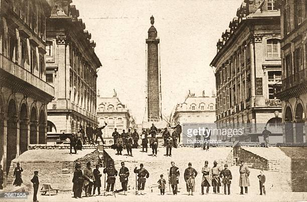 The scene just before the demolition of the Vendome Column, Napoleon's triumphal monument in the Place Vendome, Paris. It was pulled down by the...