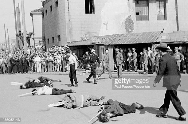 The scene moments after five Chinese prisoners were executed by a bullet to the head for economic racketeering in Shanghai circa May 1949 Attached to...