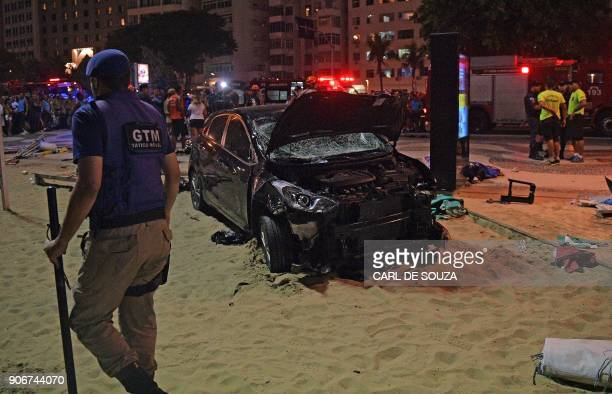TOPSHOT The scene of a car crash pictured at Copacabana beach in Rio de Janeiro on January 18 2018 At least 11 people were injured by a car that...