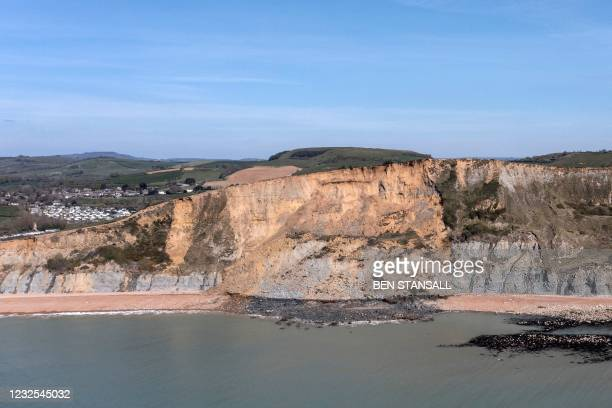 The scene of a coastal cliff fall is seen on Dorset's Jurassic Coast near the village of Seatown, on the south west coast of England on April 26,...