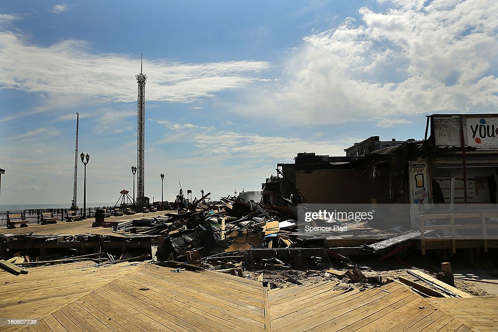 The scene of a massive fire that destroyed dozens of businesses is viewed along an iconic Jersey shore boardwalk on September 13, 2013 in Seaside Heights, New Jersey. The 6-alarm fire began in a frozen custard stand on the recently rebuilt boardwalk around 2:30 p.m. and quickly spread in high winds. While there were no injuries reported, many businesses that had only recently re-opened after Hurricane Sandy were destroyed in the blaze.