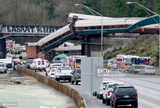 TOPSHOT The scene of a portion of the Interstate I5 highway after an Amtrak high speed train derailled from an overpass early December 18 2017 near...