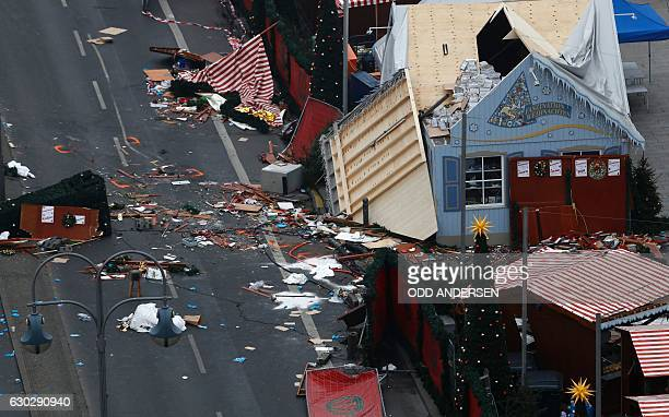 TOPSHOT The scene of a terrorist attack is seen on December 20 2016 after a lorry smashed into a busy Christmas market in central Berlin German...