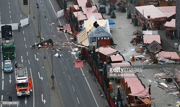 The scene of a terrorist attack is seen on December 20 2016 after a lorry smashed into a busy Christmas market in central Berlin German police said...