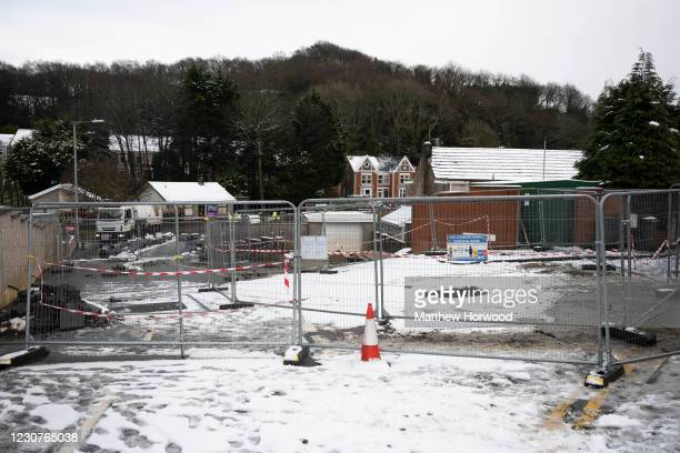 The scene of flooding where water flowed down a road is fenced off in Skewen on January 24, 2021 in Neath Port Talbot, Wales. Serious flooding was...