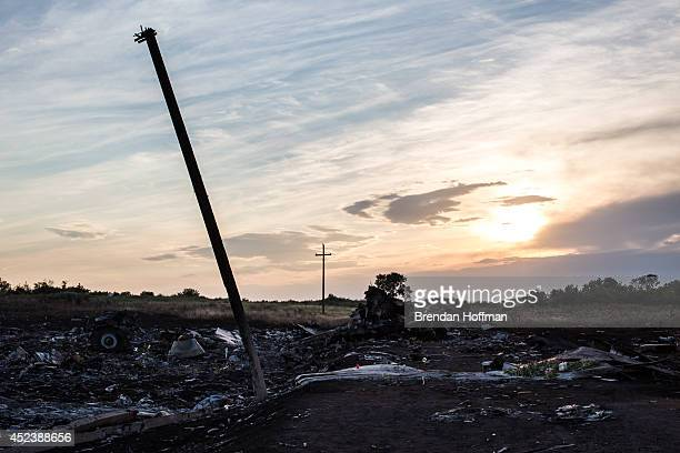 The scene of the crash of Malaysia Airlines flight MH 17 at sunset after pro-Russia separatist fighters established control of the site on July 19,...