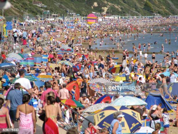 The scene on the beach at Branksome Poole in Dorsetas blue skies and sunshine brought thousands to the coast to the enjoy the Bank Holiday weekend