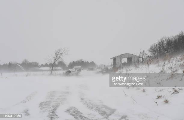 The scene on the Krocak Farm as a snow squall comes through on December 9 2019 in Montgomery MN Dairy and crop farmers across the Midwest are going...