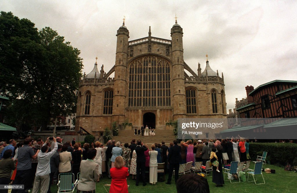 The scene outside St George's Chapel in windsor Castle, where Prince Edward, the youngest son of Britain's Queen Elizabeth II, married Sophie Rhys-Jones. The royal couple can be seen with their pageboys and bridesmaids on the steps of the Chapel.