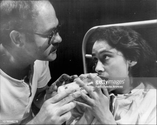 The scene shows Eddie a radical American therapist bottle feeding milk to Mary during a long and eventually rewarding treatment to Mary a...