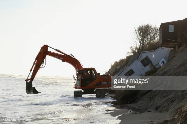 The scene where properties have fallen into the sea due to the cliff collapsing on December 6, 2013 in Hemsby, England. Thousands of people were...