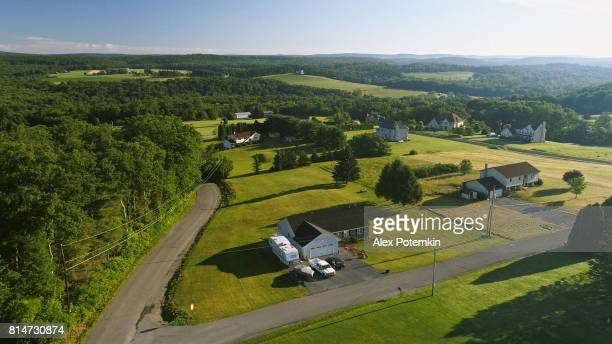 the scenery aerial view of poconos, monroe county, pennsylvania. the sunny summer morning. the panoramic overview over the field and forest to the kunkletown, then to the small farm near by the road. - pennsylvania stock pictures, royalty-free photos & images