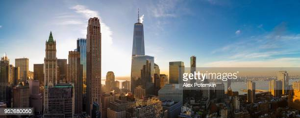 the scenic aerial view of the liberty tower over manhattan downtown includes the major skyscrapers: the woolworth building, transportation building, barclay tower, and more. - lower manhattan stock photos and pictures