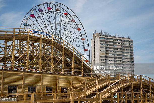 The Scenic Railway and The Big Wheel Of Colour rides at Dreamland amusement park are seen in front of a block of flats on June 18 2015 in Margate...
