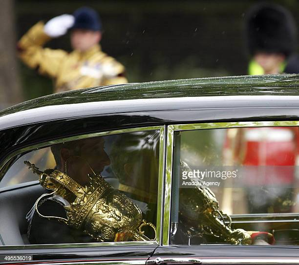 The scepter of Queen Elizabeth II is carried to parliement ahead of the State Opening of Parliament on June 4 2014 in London England Queen Elizabeth...