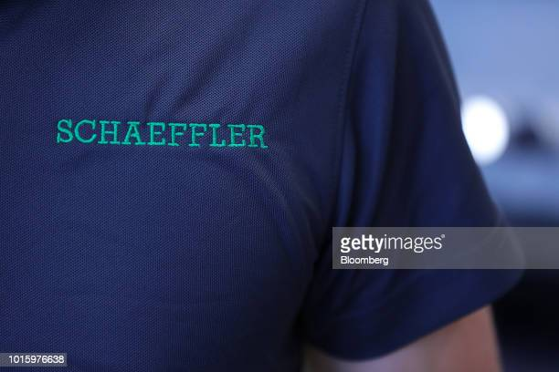 The Schaeffler AG logo sits on an employee's shirt inside the company's factory in Herzogenaurach Germany on Tuesday July 3 2018 Schaeffler the...
