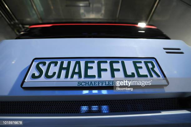 The Schaeffler AG logo sits on the registration plate of a Schaeffler Mover electric autonomous vehicle during testing in the company's factory in...