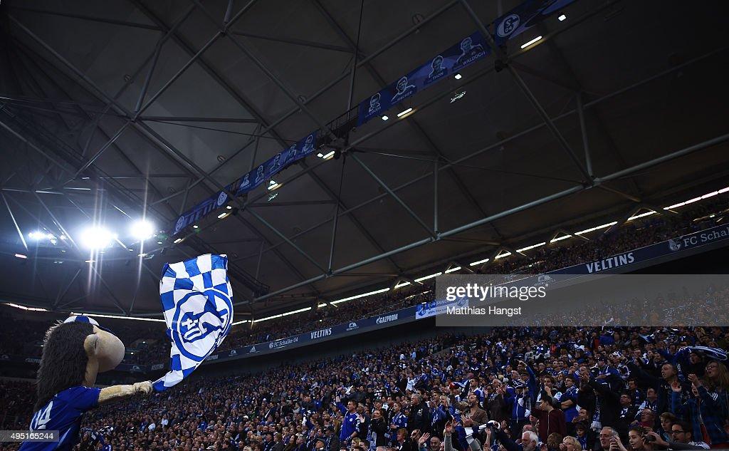 The Schalke 04 mascot Erwin motivates the fans during the Bundesliga match between FC Schalke 04 and FC Ingolstadt at Veltins-Arena on October 31, 2015 in Gelsenkirchen, Germany.