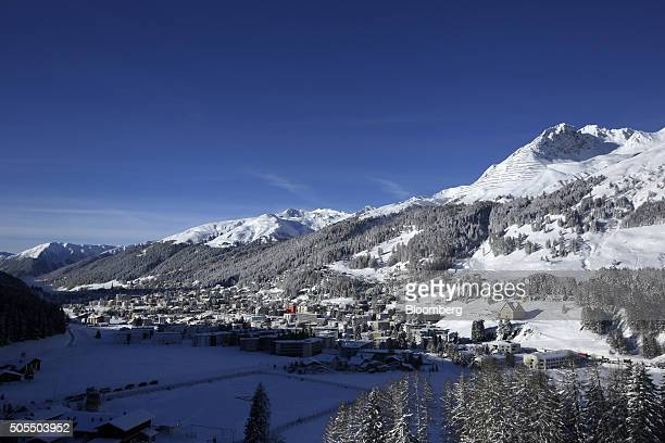 The Schatzalp mountains are seen standing beyond commercial buildings and residential apartments from a guests' bedroom balcony at the...